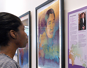 Person viewing a DNA Portrait and storyboard of a man from Laos